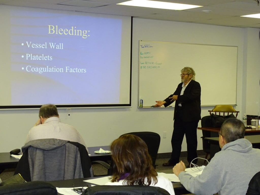 Dr. Patrick Quaranta lecturing to attendees in our facility