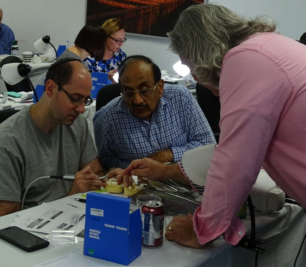 Dr. Papadakis works closely to guide attendees during the hands-on portion of his course